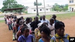 Votera wait in line in front of a polling station on December 17, 2011 in Mouila. Turnout was low as Gabon voted in legislative elections boycotted by part of the opposition in the west African oil state.