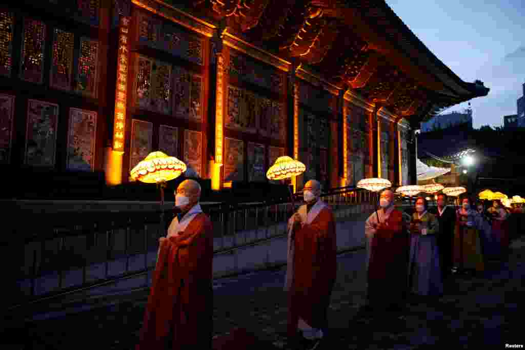 Buddhist monks and believers attend a lantern parade in celebration of the upcoming birthday of Buddha at a temple in Seoul, South Korea.
