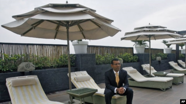 Former Maldives President Mohamed Nasheed poses for a picture at the poolside of a hotel in New Delhi, India, April 18, 2012.