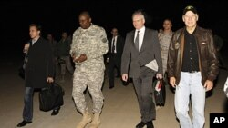 U.S. Vice President Joe Biden, right, walks with the U.S. Ambassador to Iraq James Jeffrey, center, and General Lloyd Austin, the top U.S. commander in Iraq, 2nd left, after his arrival in Baghdad, Iraq, November 29, 2011.