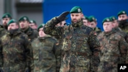 German Bundeswehr soldiers of the 12th Mechanized Infantry Brigade, 122nd Infantry Battalion, take part in a NATO enhanced forward presence battalion welcome ceremony at the Rukla military base 130 km (80 miles) west of Vilnius, Lithuania, Feb. 7, 2017.