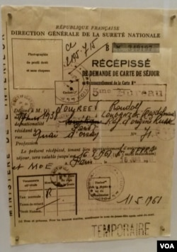 On display is the yellowed visa French authorities gave to star Soviet dancer Rudolph Nureyev when he defected to the West in 1961. (L. Bryant/VOA)