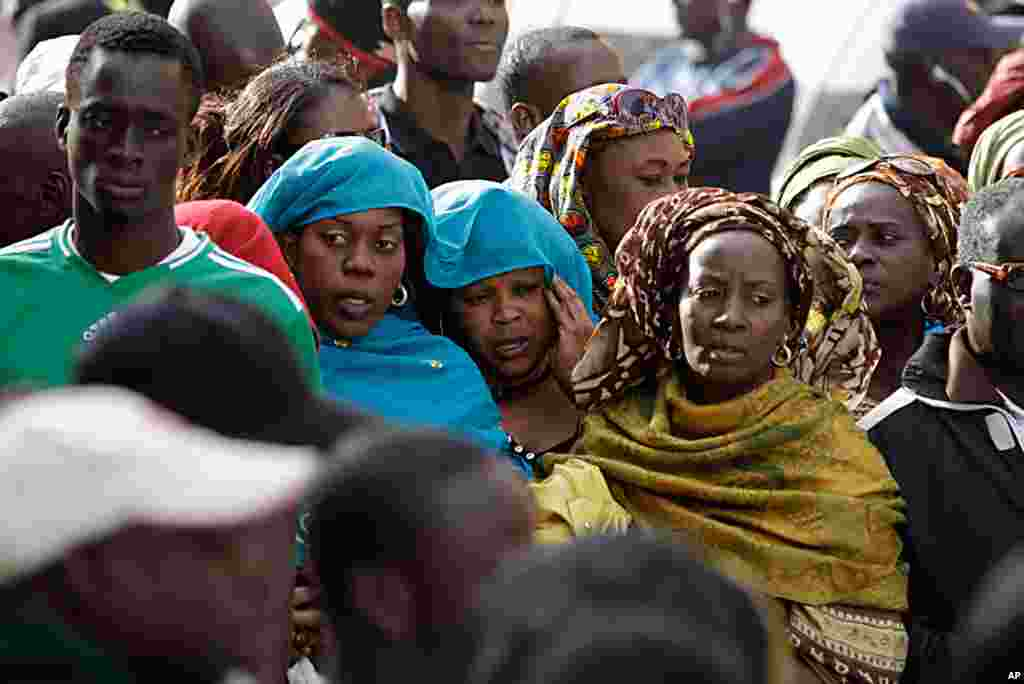 Women participate in a prayer by anti-government protesters on a street leading to Independence Square, where police have blocked the opposition from demonstrating, in Dakar, Senegal Feb. 23, 2012. (AP)