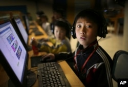 A North Korean school boy looks up from his computer screen at the Sci-Tech Complex in Pyongyang, April 17, 2017.