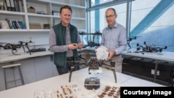 In this photo, Dr Stephen Pawson and Dr Graeme Woodward of New Zealand's University of Canterbury display their equipment used in their wireless solution for tracking insects using radar mounted on drones. (Photo Credit: University of Canterbury)