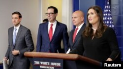Homeland security adviser Tom Bossert, U.S. Treasury Secretary Steve Mnuchin, national security adviser H.R. McMaster and White House press secretary Sarah Huckabee Sanders announce sanctions against Venezuela, Aug. 25, 2017.