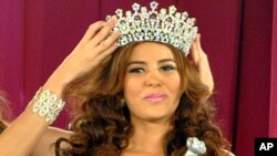 FILE - Maria Jose Alvarado is crowned the new Miss Honduras in San Pedro, Sula, Honduras, April 26, 2014.