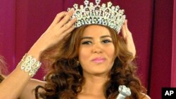 FILE - Maria Jose Alvarado is crowned the new Miss Honduras in San Pedro, Sula, Honduras, April 26, 2014.