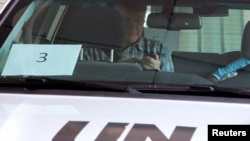 Ake Sellstrom, head of a United Nations (U.N.) chemical weapons investigation team, sits in a U.N. vehicle as he leaves the hotel where the team is staying, in Damascus Sep. 26, 2013. U.N.