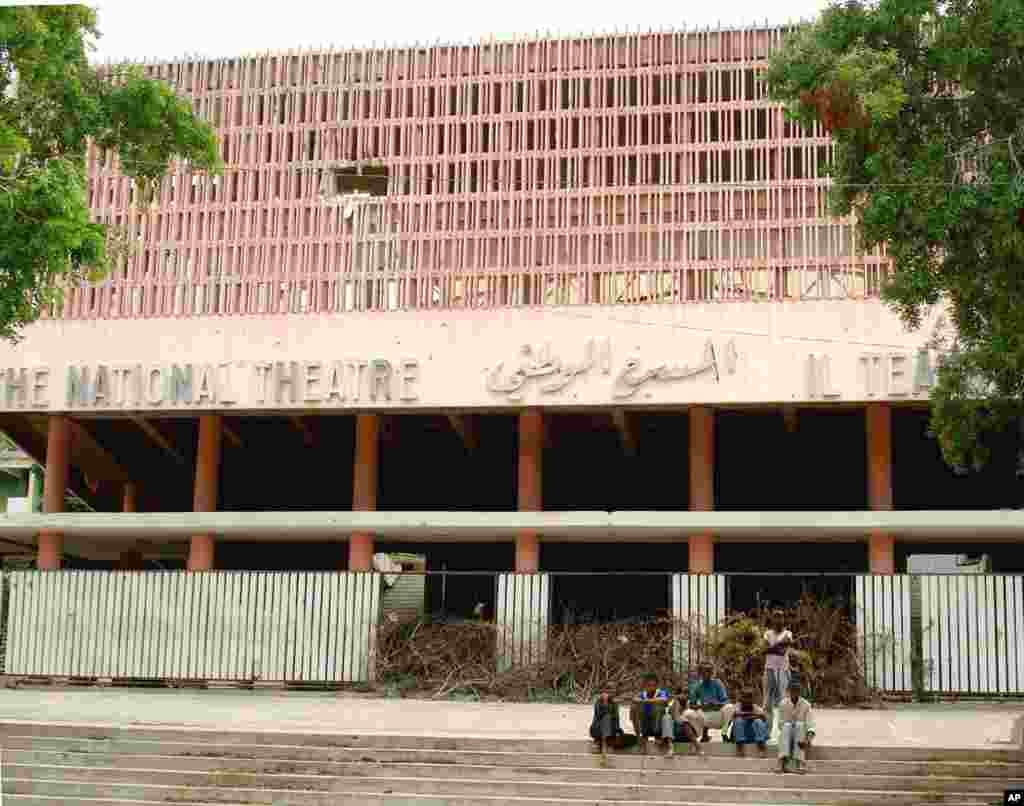 Somali children sit in front the war-devastated national theatre of Somalia in the capital Mogadishu. August 8, 2006. (Reuters)