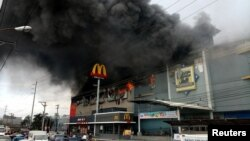Smoke billows from a shopping mall fire in Davao City, the Philippines, Dec. 23, 2017, in a photo obtained from social media. (Yas D. Ocampo/via Reuters)