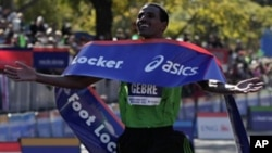 Gebre Gebremariam of Ethiopia celebrates after winning the professional men's division at the New York City marathon in New York, Sunday, Nov. 7, 2010.