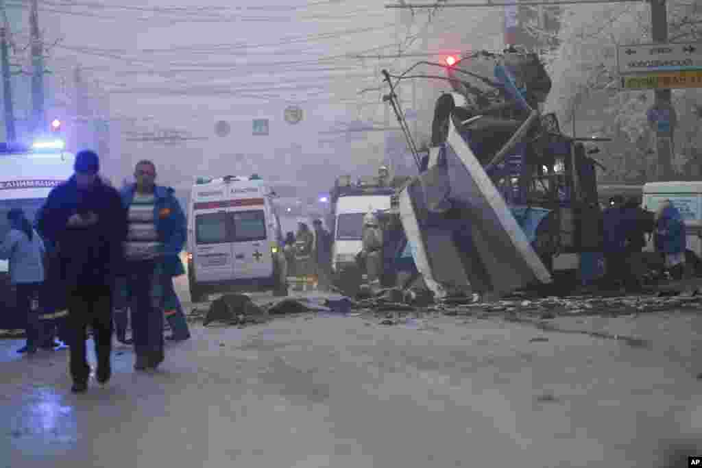 Ambulances line up at the site of a trolleybus explosion, background, in Volgograd, Russia. A bomb blast tore through the trolleybus in the city, killing at least 10 people a day after a suicide bombing that killed at 17 at the city's main railway station.