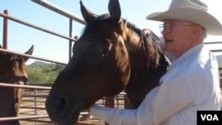 Rancher Jim Chilton with his horse Arnold near Arivaca, Arizona, July 12, 2016. (G. Flakus/VOA)