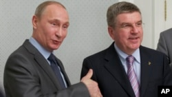 FILE - Russian President Vladimir Putin (L) and International Olympic Committee President Thomas Bach meet at the Bocharov Ruchei residence at the Black Sea resort of Sochi, southern Russia, Oct. 28, 2013.