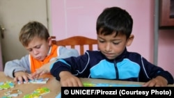October 2016, Tirana the capital. Children from the ROMA community in art class assisted by educators. The House of colours centre closely cooperates with all relevant state authorities, including the police, State Social Services, Child Protection Unit