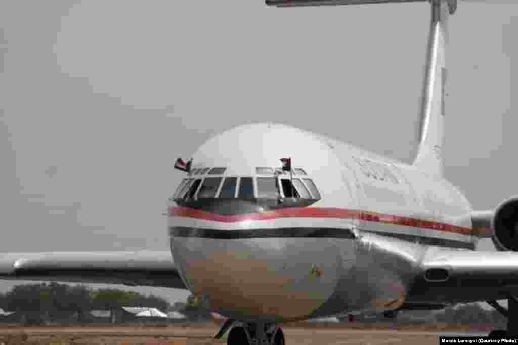 The plane carrying Sudanese President Omar al Bashir to his first visit of South Sudan taxis to a halt at Juba airport on Friday, April 12, 2013.