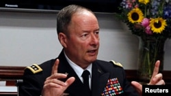 General Keith Alexander, director of the National Security Agency (NSA) and U.S. Cyber Command speaks to reporters during the Reuters Cybersecurity Summit in Washington, May 14, 2013.