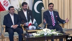 Pakistan's Prime Minister Yousuf Raza Gilani (R) holds meeting with visiting Iranian President Mahmoud Ahmadinejad at the prime minister's house in Islamabad, Pakistan, February 16, 2012.