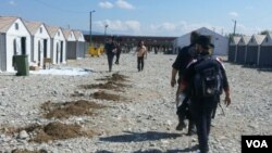 Young men cross border from Greece to Macedonia, Sept. 13, 2015. (Courtesy photo: shared by refugees)
