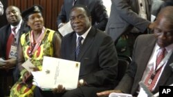FILE: Emmerson Mnangagwa, center, and Saviour Kasukuwere (far left) seen at ZANU-PF headquarters in Harare, Zimbabwe, Dec, 10, 2014.