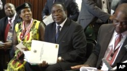 FILE: Emmerson Mnangagwa, center, is seen at ZANU-PF headquarters in Harare, Zimbabwe, Dec, 10, 2014.