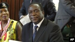 Emmerson Mnangagwa appears at ZANU-PF headquarters in Harare, Zimbabwe, Dec. 10, 2014.