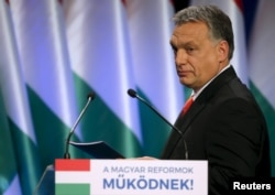 "FILE - Hungarian Prime Minister Viktor Orban arrives to deliver his state-of-the-nation speech in Budapest, Hungary, Feb. 28, 2016. Orban has called U.S. presidential candidate Donald Trump an ""upstanding candidate."""