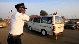 A policeman regulates traffic in Monrovia, Liberia, Jan. 29, 2013.