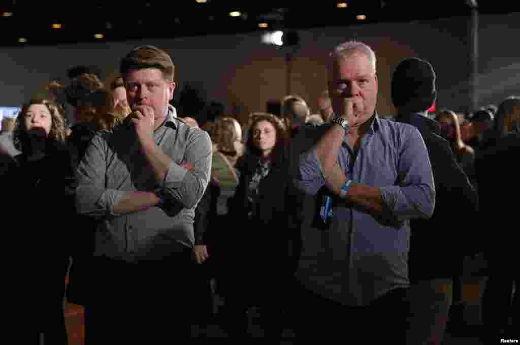 Supporters of Democratic presidential candidate former Vice President Joe Biden watch television results at his rally in Des Moines, Iowa, Feb. 3, 2020.