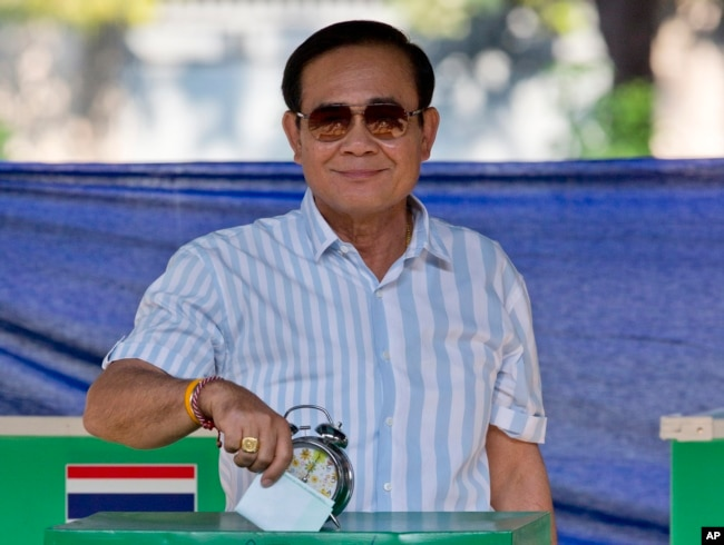 Thailand's Prime Minister Prayuth Chan-ocha casts his vote at a polling station in Bangkok, Thailand, March 24, 2019, during the nation's first general election since the military seized power in a 2014 coup.