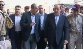 Iraqi Prime Minister Nouri al-Maliki, second right, visits a revered Shi'ite shrine in Samarra, Iraq, June 13, 2014.