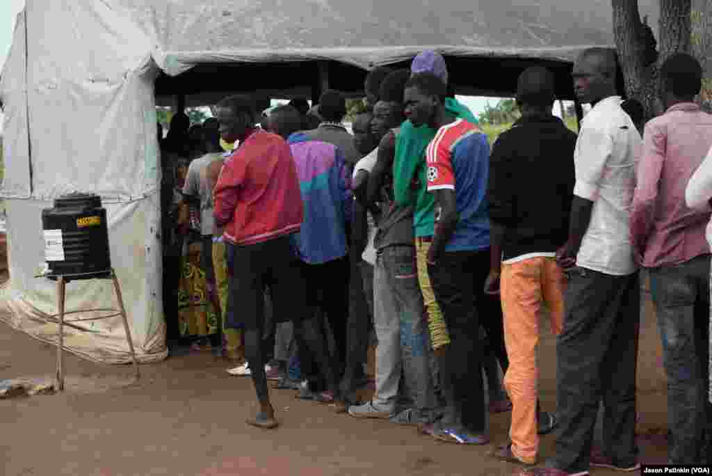 South Sudanese refugees line up for registration in Uganda.