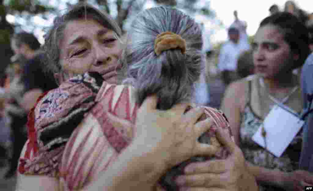 Relatives of victims killed during Argentina's dirty war embrace at the end of the trial of former dictator Jorge Videla in Cordoba, Argentina, Wednesday Dec. 22, 2010. Videla was sentenced to life in prison Wednesday for the torture and murder of 31 pri