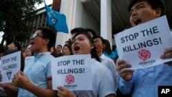 Tư liệu - Sinh viên Đại học Philippines biểu tình tưởng niệm những người bị sát hại trong cuộ chiến chống ma túy của Tổng thống Rodrigo Duterte, ngày 27 tháng 3, 2019, ở ngoại ô Thành phố Quezon nằm ở đông bắc Manila, Philippines.