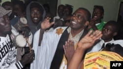 FILE - In this May 2016 photo, Mauritania anti-slavery activist Biram Ould Dah Ould Abeid (C) is welcomed by supporters after the country's supreme court downgraded the crimes he and others were convicted of in 2015 and ordered their release.