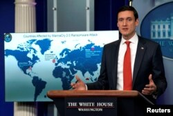 FILE - Tom Bossert, homeland security adviser to President Donald Trump, holds a press briefing to publicly blame North Korea for unleashing the so-called WannaCry cyber attack at the White House in Washington, Dec. 19, 2017.