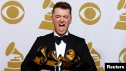 Sam Smith holds his four Grammys in the press room at the Grammy Awards in Los Angeles, California, February 8.