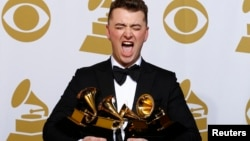 Sam Smith poses with his awards including one for Best New Artist.