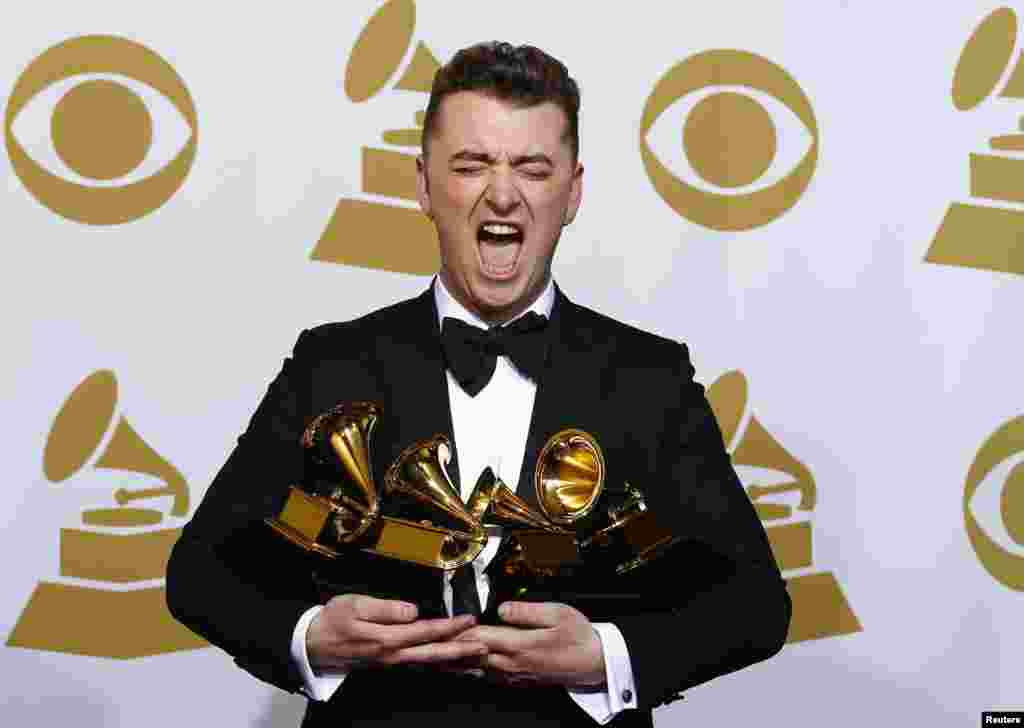 "Sam Smith poses with his awards for Best New Artist, Best Pop/Vocal Album for ""In the Lonely Hour"" and Song of the Year and Record of the Year for ""Stay With Me"" in the press room at the 57th annual Grammy Awards in Los Angeles, California, Feb. 8, 2015."