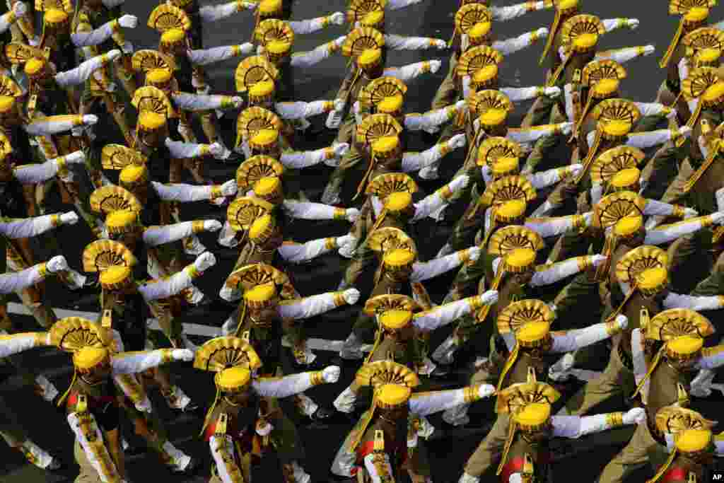 Soldiers of India's Central Reserve Police Force march during a full dress rehearsal of the Republic Day parade, in Kolkata.