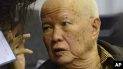 In this photo released by the Extraordinary Chambers in the Courts of Cambodia, Khieu Samphan, a former head of state for the Khmer Rouge, gestures as testimony is given during his trial at the U.N.-backed war crimes tribunal in Phnom Penh, file photo.