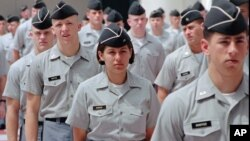 FILE - Citadel cadets march in formation at the military college in Charleston, South Carolina.