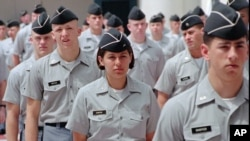 FILE - Citadel cadets march in formation at the military college in Charleston, S.C.