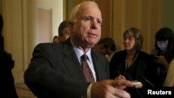 FILE - Sen. John McCain talks to the media on Capitol in Washington June 18, 2015.