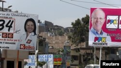 Electoral posters of Peru's presidential candidates Keiko Fujimori of the Fuerza Popular party and Pedro Pablo Kuczynski of the Peruanos Por El Cambio party are seen in Villa Maria del Triunfo on the outskirts of Lima, Peru, April 6, 2016.