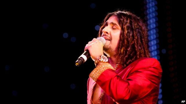 FILE - Indian Bollywood singer Sonu Nigam performed at The Asian Awards at Grosvenor House Hotel, Park Lane, London, Oct. 26, 2010. Five Jet Airways crew were suspended after allowing Nigam to sing on their flight.