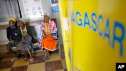 FILE - Malagasy women wait to be seen by a doctor in a clinic in Antananarivo, Madagascar.