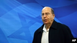 FILE - Israeli Defense Minister Moshe Ya'alon arrives at the weekly cabinet meeting at the prime minister's Jerusalem office.