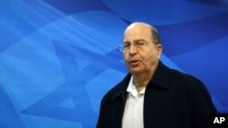 FILE - Israeli Defense Minister Moshe Yaalon arrives at the weekly cabinet meeting at the prime minister's Jerusalem office.